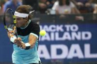 "Rafael Nadal of Spain hits return to Novak Djokovic of Serbia during their ""Back To Thailand - Nadal vs Djokovic"" friendly tennis match in Bangkok, Thailand, October 2, 2015. REUTERS/Athit Perawongmetha"