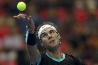 "Rafael Nadal of Spain serves to Novak Djokovic of Serbia during ""Back To Thailand - Nadal vs Djokovic"" friendly tennis match in Bangkok, Thailand, October 2, 2015. REUTERS/Athit Perawongmetha"
