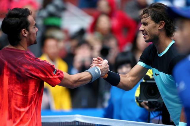 Rafael Nadal of Spain (R) shakes hands with Fabio Fognini of Italy after the semi-final match in the China Open tennis tournament at the National Tennis Center in Beijing, China, 10 October 2015. (España, Tenis, Italia) EFE/EPA/WU HONG