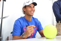 Rafael Nadal of Spain signs autographs on day two of the 2015 China Open at the China National Tennis Centre on on October 4, 2015 in Beijing, China. (Oct. 3, 2015 - Source: Chris Hyde/Getty Images AsiaPac)