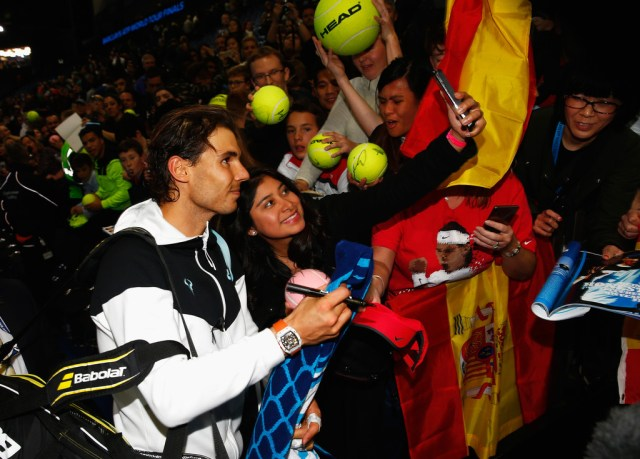 Rafael Nadal of Spain poses for a selfie after his men's singles match against Stanislas Wawrinka of Switzerland during day two of the Barclays ATP World Tour Finals at O2 Arena on November 16, 2015 in London, England. (Nov. 15, 2015 - Source: Julian Finney/Getty Images Europe)