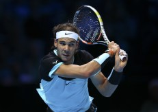 LONDON, ENGLAND - NOVEMBER 18: Rafael Nadal of Spain plays a backhand in his men's singles match against Andy Murray of Great Britain during day four of the Barclays ATP World Tour Finals at the O2 Arena on November 18, 2015 in London, England. (Photo by Clive Brunskill/Getty Images)
