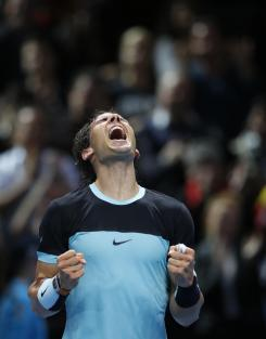 Rafael Nadal of Spain celebrates after defeating David Ferrer of Spain in their singles tennis match at the ATP World Tour Finals at the O2 Arena in London, Friday, Nov. 20, 2015. (AP Photo/Alastair Grant)