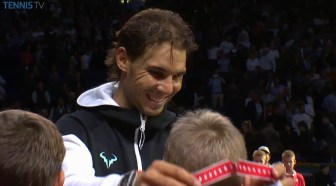 Rafael Nadal hands out medal to ballkids in Basel