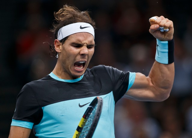 Rafael Nadal of Spain celebrates as he is wins a point against Kevin Anderson of South Africa during their third round match of the BNP Masters tennis tournament at the Paris Bercy Arena, in Paris, France, Thursday, Nov. 5, 2015. (AP Photo/Michel Euler)