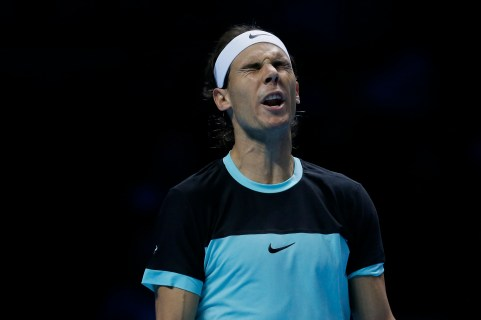 Spain's Rafael Nadal reacts after losing a point to Serbia's Novak Djokovic during their ATP World Tour Finals tennis match at the O2 Arena in London, Saturday Nov. 21, 2015. (AP Photo/Tim Ireland)