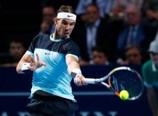 Rafael Nadal of Spain returns a ball to Switzerland's Roger Federer during their match at the Swiss Indoors ATP men's tennis tournament in Basel, Switzerland November 1, 2015. REUTERS/Arnd Wiegmann