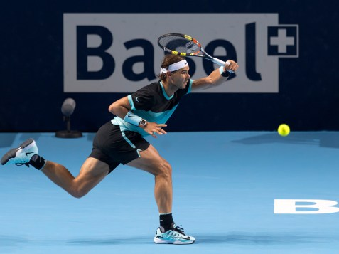 Spain's Rafael Nadal returns a ball to Switzerland's Roger Federer during their final match at the Swiss Indoors tennis tournament at the St. Jakobshalle in Basel, Switzerland, Sunday, Nov. 1, 2015. (Georgios Kefalas/Keystone via AP)