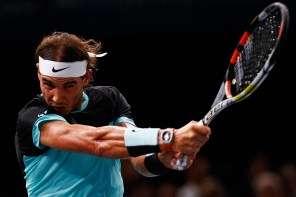 PARIS, FRANCE - NOVEMBER 06: Rafael Nadal of Spain in action against Stan Wawrinka of Switzerland during Day 5 of the BNP Paribas Masters held at AccorHotels Arena on November 6, 2015 in Paris, France. (Photo by Dean Mouhtaropoulos/Getty Images)
