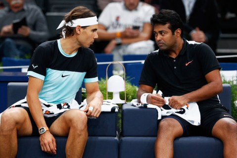 Rafael Nadal (L) of Spain and Leander Paes of India speak between a set against Dominic Inglot of Great Britain and Robert Lindstedt of Sweden during Day 2 of the BNP Paribas Masters held at AccorHotels Arena on November 3, 2015 in Paris, France. (Nov. 2, 2015 - Source: Dean Mouhtaropoulos/Getty Images Europe)
