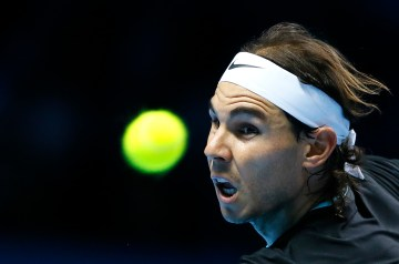 Rafael Nadal of Spain plays a return to Stan Wawrinka of Switzerland during their singles tennis match at the ATP World Tour Finals at the O2 Arena in London, Monday, Nov. 16, 2015. (AP Photo/Kirsty Wigglesworth)