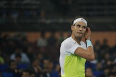 Rafael Nadal of Indian Aces adjust his hair as he plays Roger Federer of UAE Royals in the men's singles event of the International Premier Tennis League in New Delhi, India, Saturday, Dec. 12, 2015. (AP Photo /Tsering Topgyal)