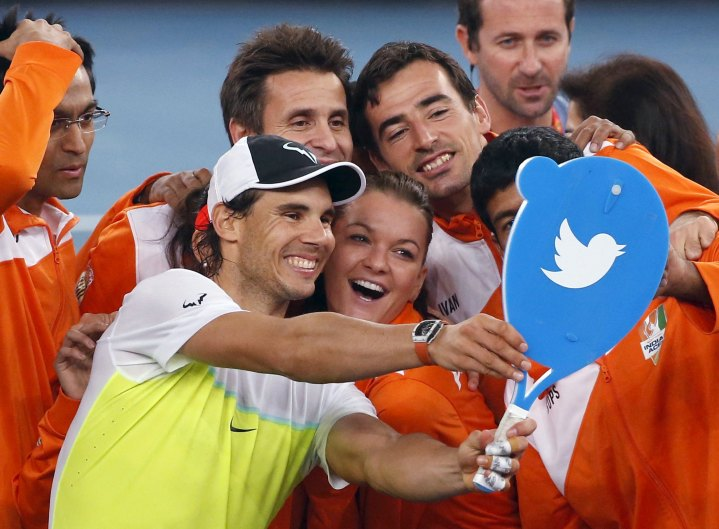 Indian Aces' Rafael Nadal of Spain (2nd L) take a selfie photo with his team members after winning his men's singles match against Philippine Mavericks' Edouard Roger-Vasselin of France (unseen) in the International Premier Tennis League (IPTL) in New Delhi, India, December 10, 2015. REUTERS/Anindito Mukherjee