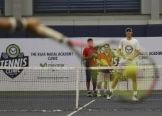 Spain's Rafael Nadal, right, conducts a tennis clinic in Makati, south of Manila, Philippines Sunday, Dec. 6, 2015. Nadal is in the country to promote his tennis academy and to compete in the International Premier Tennis League (IPTL). (AP Photo/Aaron Favila)