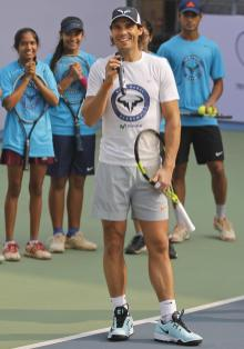 Spain's Rafael Nadal speaks before playing with young tennis enthusiasts at a promotional event in New Delhi, India, Thursday, Dec. 10, 2015. Nadal, who plays for Indian Aces in the International Professional Tennis League (IPTL), is in India to play a leg of the league. (AP Photo/Altaf Qadri)