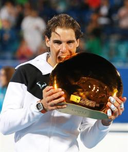 Spain's Rafael Nadal poses with his trophy after defeating Milos Raonic of Canada in their final match of the Mubadala World Tennis Championship in Abu Dhabi, United Arab Emirates, 02 January 2016. (Tenis) EFE/EPA/ALI HAIDER