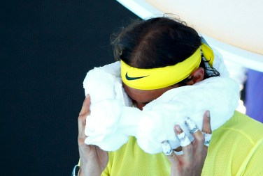 Spain's Rafael Nadal wipes his face with an ice pack during his first round match against Spain's Fernando Verdasco at the Australian Open tennis tournament at Melbourne Park, Australia, January 19, 2016. REUTERS/Thomas Peter