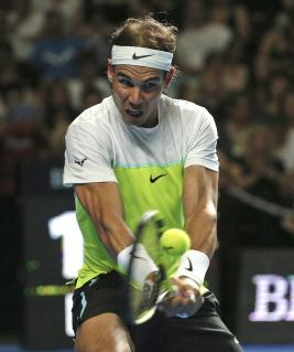 Rafael Nadal of Spain plays a shot in his match against Lleyton Hewitt of Australia during the Fast4 tennis tournament in Sydney, Australia, Monday, Jan. 11, 2016. (AP Photo/Rob Griffith)