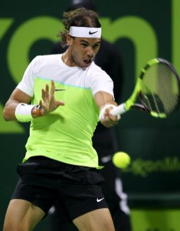 Rafael Nadal of Spain returns the ball to Novak Djokovic of Serbia during their Qatar Open men's single tennis final match in Doha, Qatar, January 9, 2016. REUTERS/Ibraheem Al Omari
