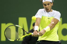 Spain's Rafael Nadal returns the ball during a match against Andrey Kuznetsov of Russia at Qatar Open tennis tournament Thursday, Jan. 7, 2016, in Doha, Qatar. (AP Photo/Alexandra Panagiotidou)