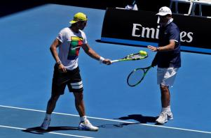 Rafael Nadal of Spain (L) is given some tennis balls from his Coach Toni Nadal during a practice session ahead of the Australian Open tennis tournament at Melbourne Park, in Melbourne, Australia, 17 January 2016. The Australian Open tennis tournament runs from 18 to 31 January 2016. (España, Tenis) EFE/EPA/MAST IRHAM