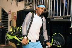 SAN JUAN, PUERTO RICO - MARCH 21: Rafael Nadal makes the entrance to Exhibition Match between Rafael Nadal vs Victor Estrella at Coliseo Jose M. Agrelot on March 21, 2016 in San Juan, Puerto Rico. (Photo by GV Cruz/WireImage)