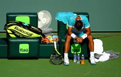 KEY BISCAYNE, FL - MARCH 26: Rafael Nadal of Spain waits for a doctor before retiring during a match against Damir Dzumhur of Bosnia and Herzegovina during Day 6 of the Miami Open presented by Itau at Crandon Park Tennis Center on March 26, 2016 in Key Biscayne, Florida. (Photo by Mike Ehrmann/Getty Images)