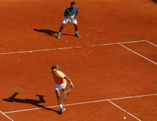 MONTE-CARLO, MONACO - APRIL 11: Rafael Nadal of Spain (L) makes a return as Fernando Verdasco of Spain (R) looks on in the doubles against Philipp Kohlschreiber of Germany and Viktor Troicki of Serbia during day two of the Monte Carlo Rolex Masters at Monte-Carlo Sporting Club on April 11, 2016 in Monte-Carlo, Monaco. (Photo by Michael Steele/Getty Images)