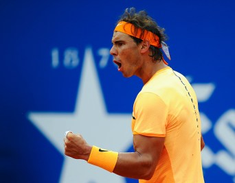 BARCELONA, SPAIN - APRIL 22: Rafael Nadal of Spain celebrates winning a point against Fabio Fognini of Italy during day five of the Barcelona Open Banc Sabadell at the Real Club de Tenis Barcelona on April 22, 2016 in Barcelona, Spain. Nadal won 6-2, 7-5. (Photo by David Ramos/Getty Images)