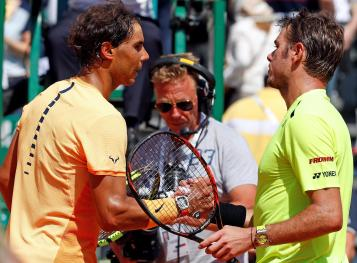 Tennis - Monte Carlo Masters - Monaco, 15/04/2016. Rafael Nadal of Spain (L) shakes hand with Stan Wawrinka of Switzerland following their match. REUTERS/Eric Gaillard