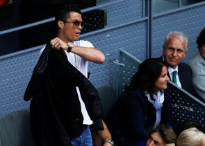 Tennis - Madrid Open - Rafael Nadal of Spain v Joao Sousa of Portugal - Madrid, Spain - 6/5/16 Real Madrid's soccer star Cristiano Ronaldo puts on his jacket as he watches the match REUTERS/Sergio Perez