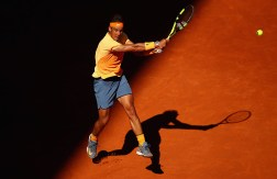 MADRID, SPAIN - MAY 03: Rafael Nadal of Spain plays a backhand against Andrey Kuznetsov of Russia in their second round match during day four of the Mutua Madrid Open tennis tournament at the Caja Magica on May 03, 2016 in Madrid,Spain. (Photo by Clive Brunskill/Getty Images)