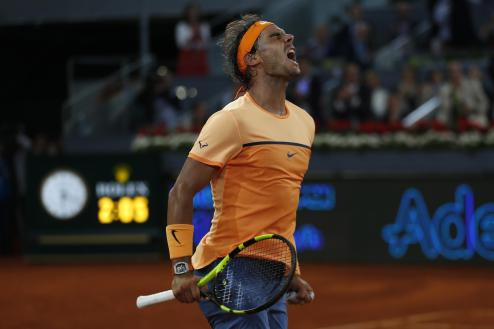 Rafael Nadal, from Spain, celebrates after winning his match against Joao Sousa, from Portugal, during a Madrid Open tennis tournament in Madrid, Spain, Friday, May 6, 2016. Nadal won 6-0, 4-6 and 6-3. (AP Photo/Francisco Seco)
