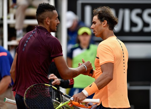ROME, ITALY - MAY 12: Nick Kyrgios of Australia and Rafael Nadal of Spain shake hands after their match on Day Five of The Internazionali BNL d'Italia on May 12, 2016 in Rome, Italy. (Photo by Dennis Grombkowski/Getty Images)