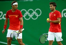 in their first round match on Day 2 of the Rio 2016 Olympic Games at the Olympic Tennis Centre on August 7, 2016 in Rio de Janeiro, Brazil. (Photo by Cameron Spencer/Getty Images)