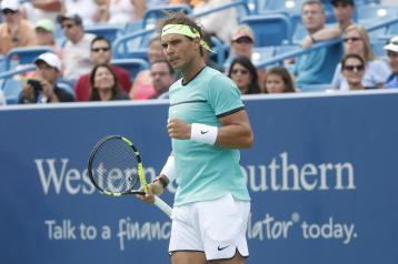Rafael Nadal, of Spain, reacts during a match against Pablo Cuevas, of Uruguay, on the fifth day of the Western & Southern Open tennis tournament, Wednesday, Aug. 17, 2016, in Mason, Ohio. (AP Photo/John Minchillo)