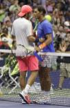 Lucas Pouille, of France, greets Rafael Nadal, of Spain, after winning their match during the fourth round of the U.S. Open tennis tournament, Sunday, Sept. 4, 2016, in New York. (AP Photo/Darron Cummings)