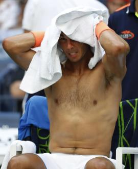Rafael Nadal, of Spain, dries his head during his match with Lucas Pouille, of France, during the fourth round of the U.S. Open tennis tournament, Sunday, Sept. 4, 2016, in New York. (AP Photo/Alex Brandon)