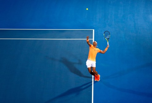 ABU DHABI, UNITED ARAB EMIRATES - DECEMBER 30: Rafael Nadal of Spain in action against Milos Raonic of Canada during day two of the Mubadala World Tennis Championship at Zayed Sport City on December 30, 2016 in Abu Dhabi, United Arab Emirates. (Photo by Francois Nel/Getty Images)