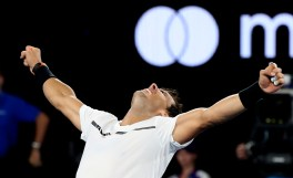 Spain's Rafael Nadal celebrates after defeating Bulgaria's Grigor Dimitrov during their semifinal at the Australian Open tennis championships in Melbourne, Australia, early Saturday, Jan. 28, 2017. (AP Photo/Aaron Favila)