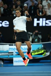 MELBOURNE, AUSTRALIA - JANUARY 25: Rafael Nadal of Spain celebrates winning his quarterfinal match against Milos Raonic of Canada on day 10 of the 2017 Australian Open at Melbourne Park on January 25, 2017 in Melbourne, Australia. (Photo by Clive Brunskill/Getty Images)