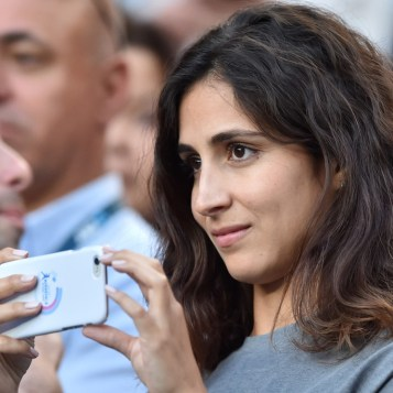 Xisca Perello, girlfriend of Spain's Rafael Nadal, uses a smartphone during his men's singles third round match against Germany's Alexander Zverev on day six of the Australian Open tennis tournament in Melbourne on January 21, 2017. / AFP / PETER PARKS / IMAGE RESTRICTED TO EDITORIAL USE - STRICTLY NO COMMERCIAL USE (Jan. 20, 2017 - Source: AFP)