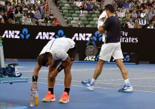 Canada's Milos Raonic, right, and Spain's Rafael Nadal change ends during their quarterfinal at the Australian Open tennis championships in Melbourne, Australia, Wednesday, Jan. 25, 2017. (AP Photo/Andy Brownbill)