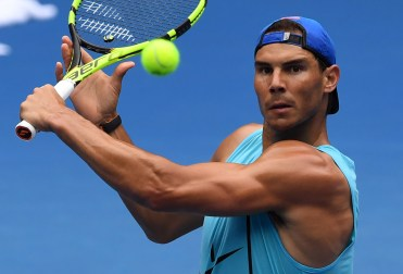 Rafael Nadal of Spain hits a backhand return during a practice session ahead of the Australian Open tennis tournament in Melbourne on January 14, 2017. / AFP / WILLIAM WEST