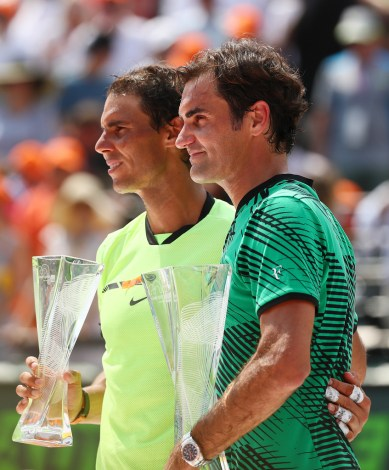 Roger Federer of Switzerland holds the winner's trophy after defeating Rafael Nadal of Spain with the runners up trophy after the Men's Final and day 14 of the Miami Open at Crandon Park Tennis Center on April 2, 2017 in Key Biscayne, Florida. (April 1, 2017 - Source: Al Bello/Getty Images North America)