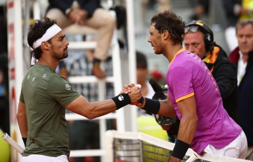 Rafael Nadal of Spain is congratulated by Fabio Fognini of Italy after his three sets win during day five of the Mutua Madrid Open tennis at La Caja Magica on May 10, 2017 in Madrid, Spain. (May 9, 2017 - Source: Julian Finney/Getty Images Europe)
