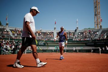 Rafael Nadal of Spain and his coach Toni Nadal attend a training session. REUTERS/Benoit Tessier