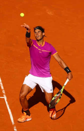 Rafael Nadal of Spain serves during his match against Fabio Fognini of Italy on day five of the Mutua Madrid Open tennis at La Caja Magica on May 10, 2017 in Madrid, Spain. (May 9, 2017 - Source: Clive Rose/Getty Images Europe)
