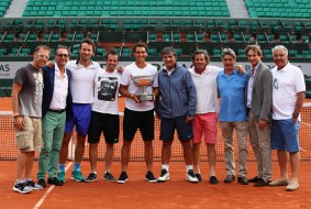 Rafael Nadal of Spain poses with the trophy and his team following victory for the 10th time in the mens singles final match against on day fifteen of the 2017 French Open at Roland Garros on June 11, 2017 in Paris, France. (June 10, 2017 - Source: Clive Brunskill/Getty Images Europe)