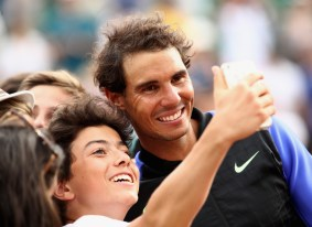 Rafael Nadal of Spain poses for selfie photograph as he celebrates victory after the men's singles final against Stan Wawrinka of Switzerland on day fifteen of the French Open at Roland Garros on June 11, 2017 in Paris, France. (June 10, 2017 - Source: Julian Finney/Getty Images Europe)